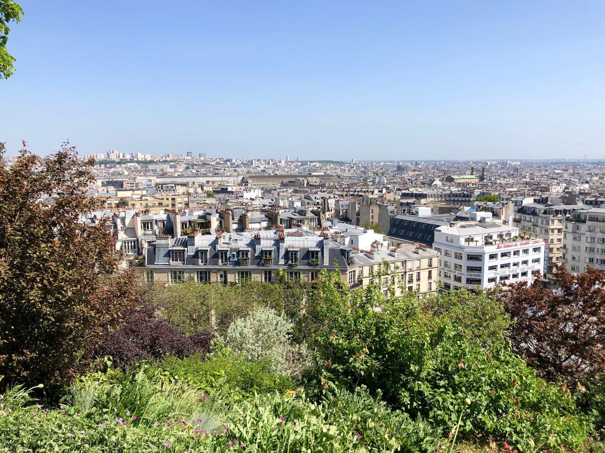 Learning French in Paris makes it easier to discover the best spots like this view point from which you can see the Paris rooftops stretch all the way to the horizon.