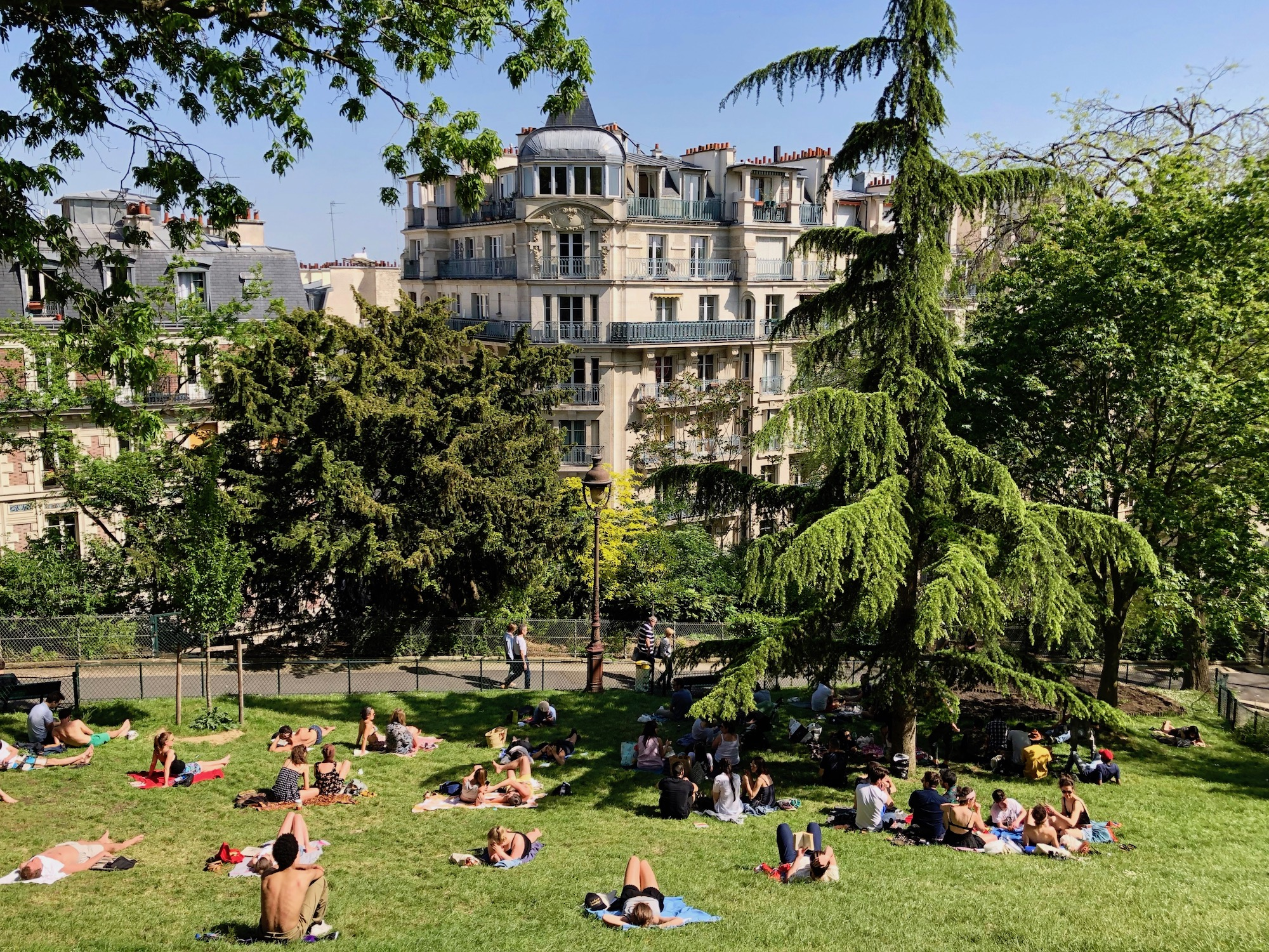 HiP Paris Blog tells you about one writer's experience learning French in Paris and how they explored the city's hidden parks like this spot behind the Sacré Coeur where locals like to tan in summer.