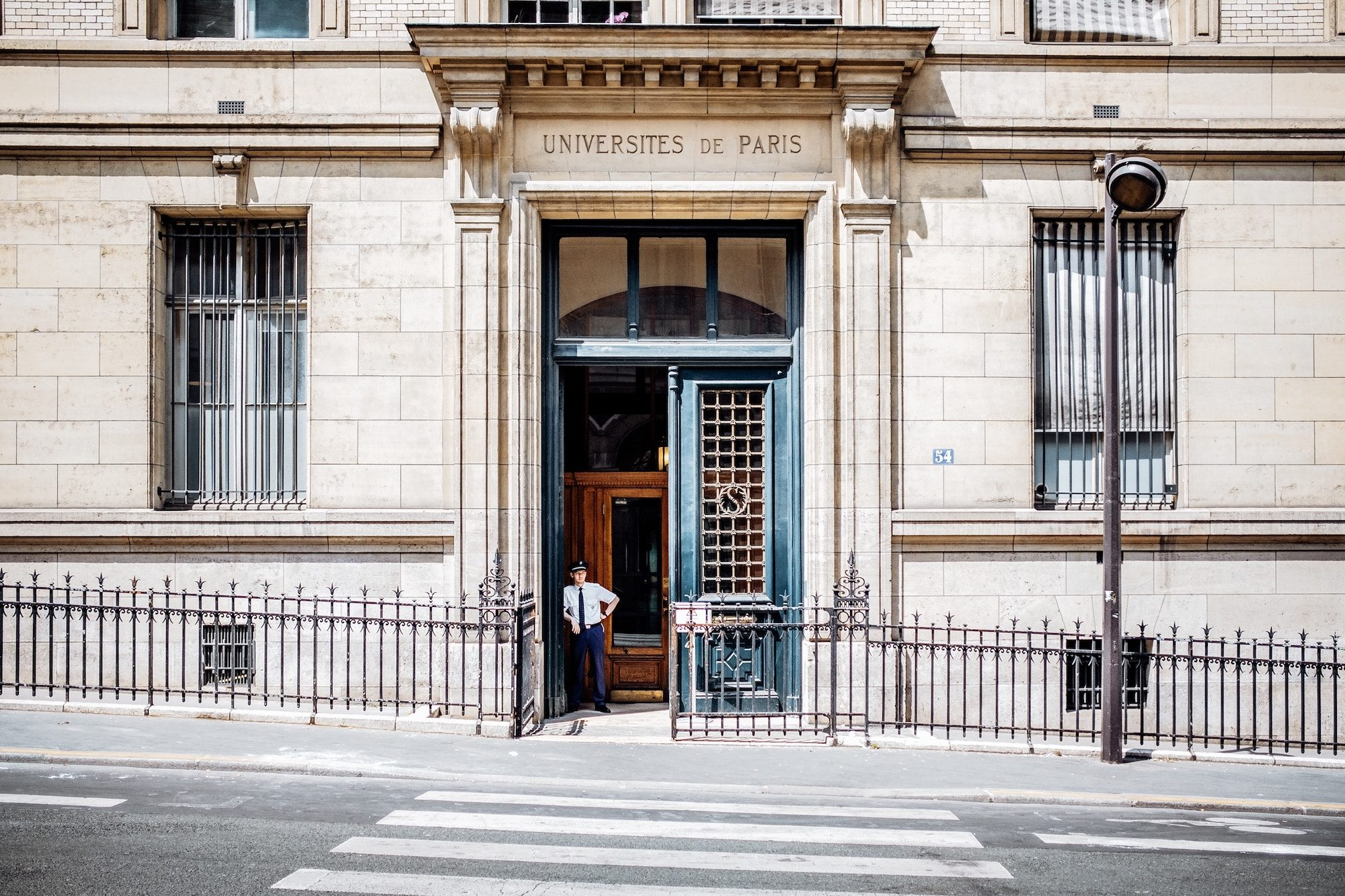 HiP Paris Blog tells the story of la rentrée, the time before everyone is back from the summer holidays, and the streets are empty of people, like outside this university with a guard standing outside.