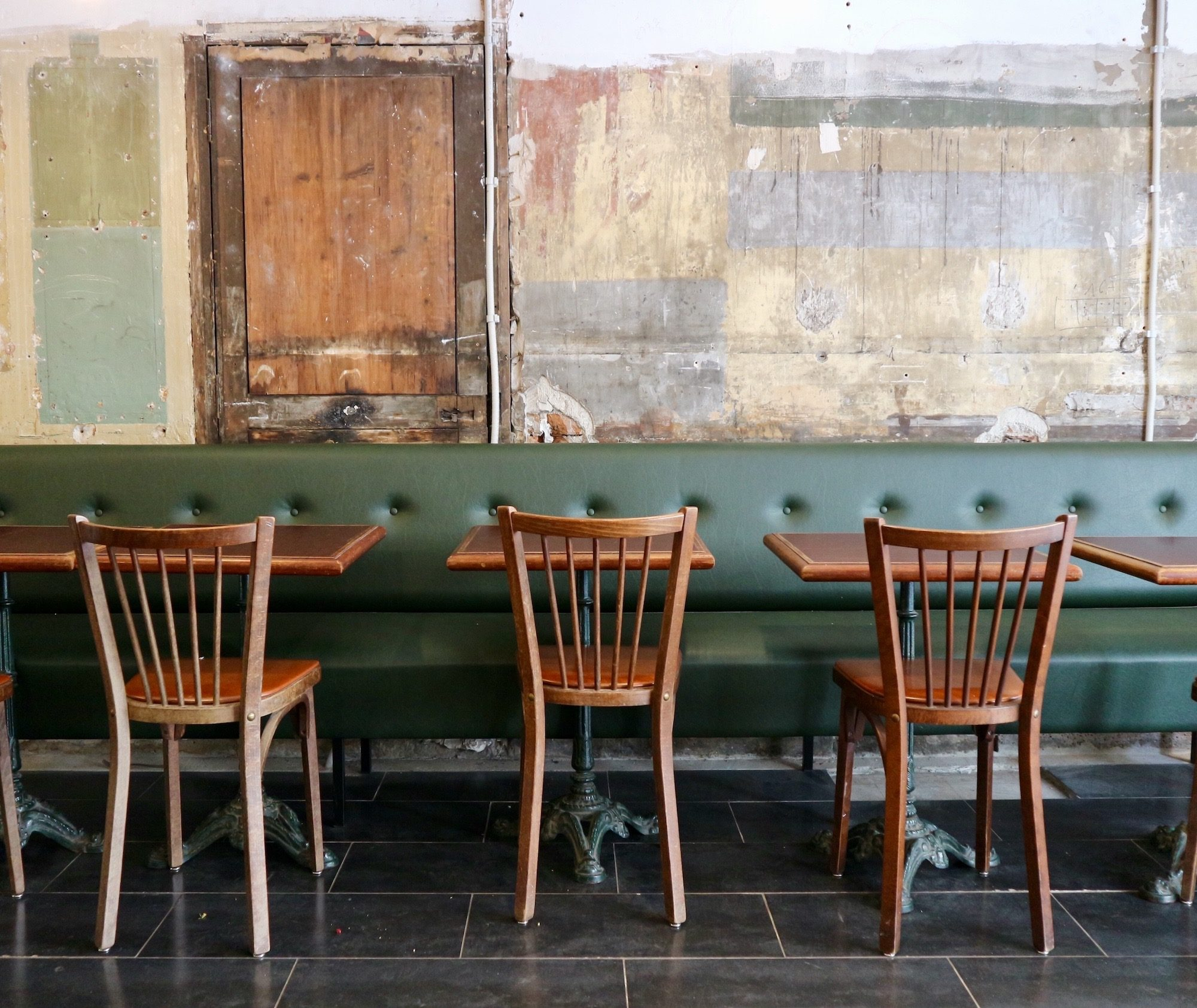 Interfabric restaurant in Paris' Batignolles neighbourhood comes with shabby chic interiors, wooden bistro tables and green leather banquettes.