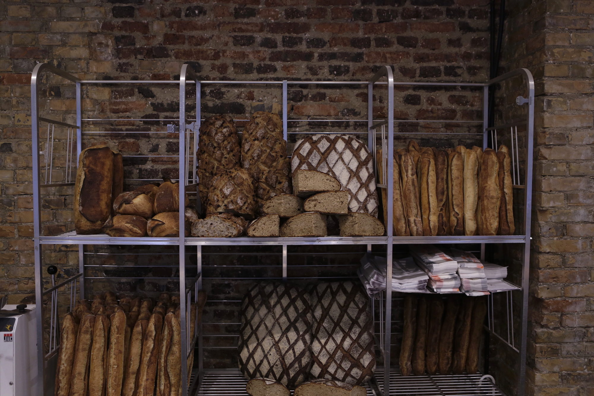 The rustic bread loaves at top Paris bakery Benoit Castel.