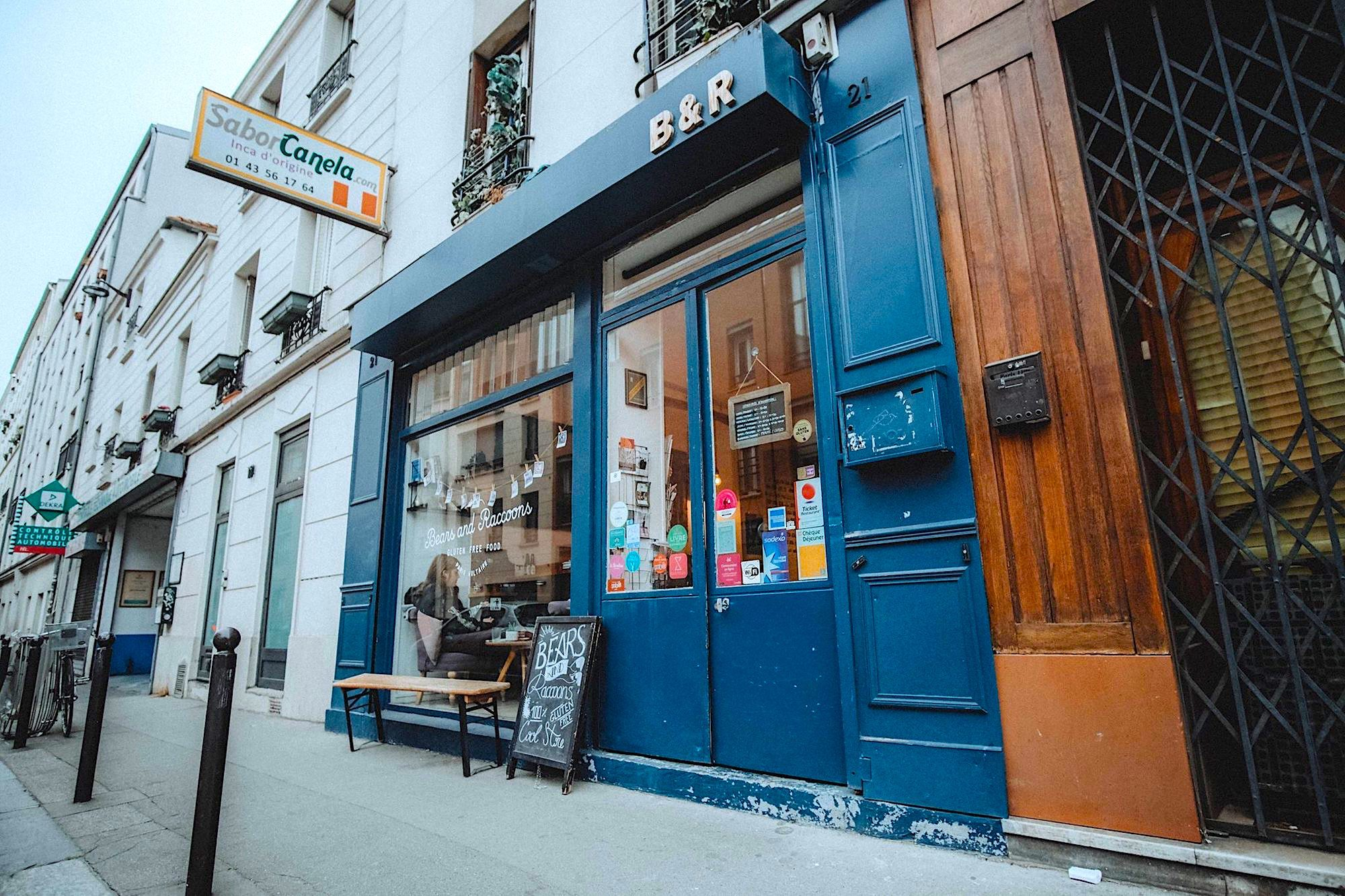 Outside Bears and Racoons gluten-free restaurant in Paris and its blue shop front.