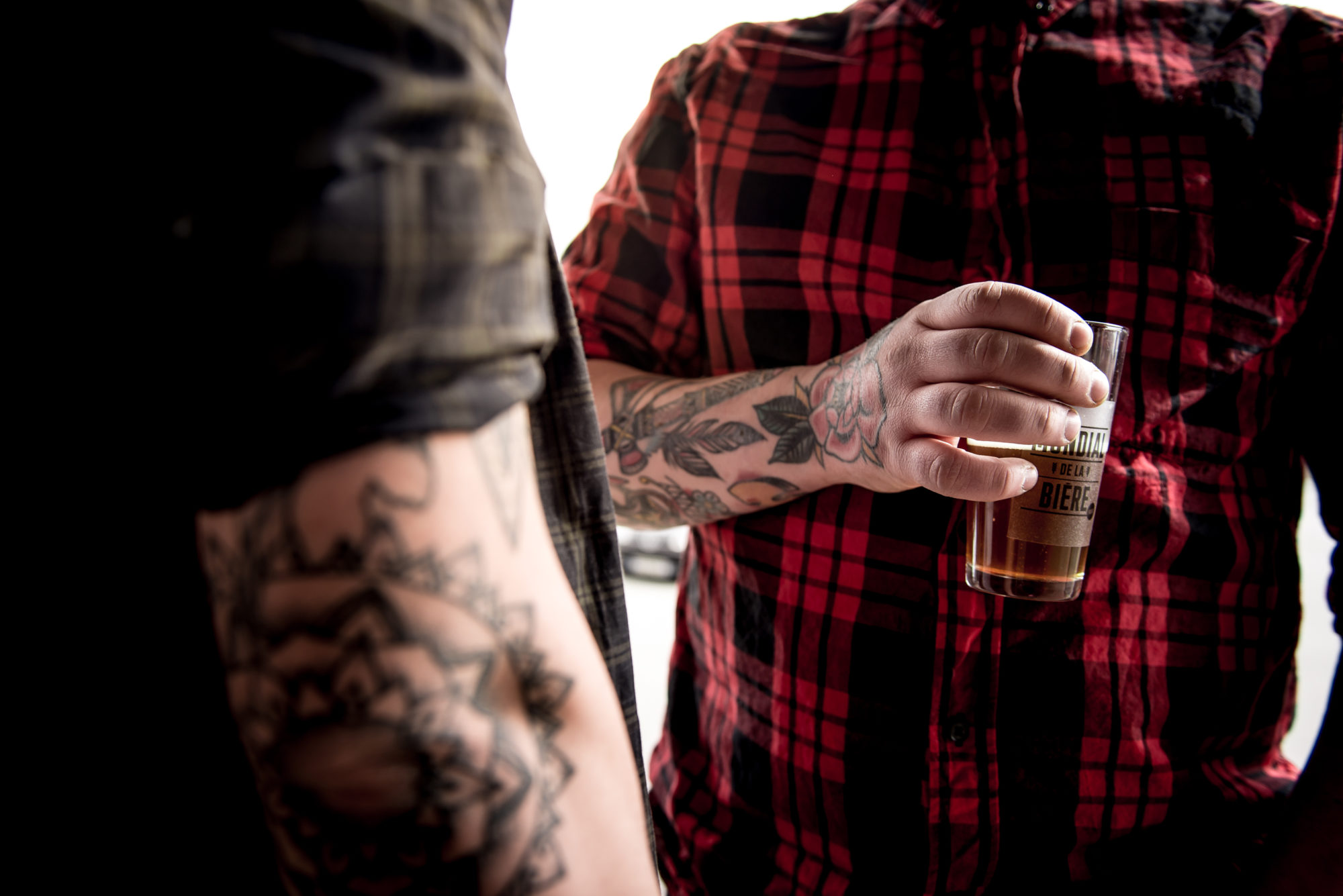 The Paris Beer Festival takes place in May, and allows you to taste lots of different craft beers like this tattooed man holding a glass of beer.