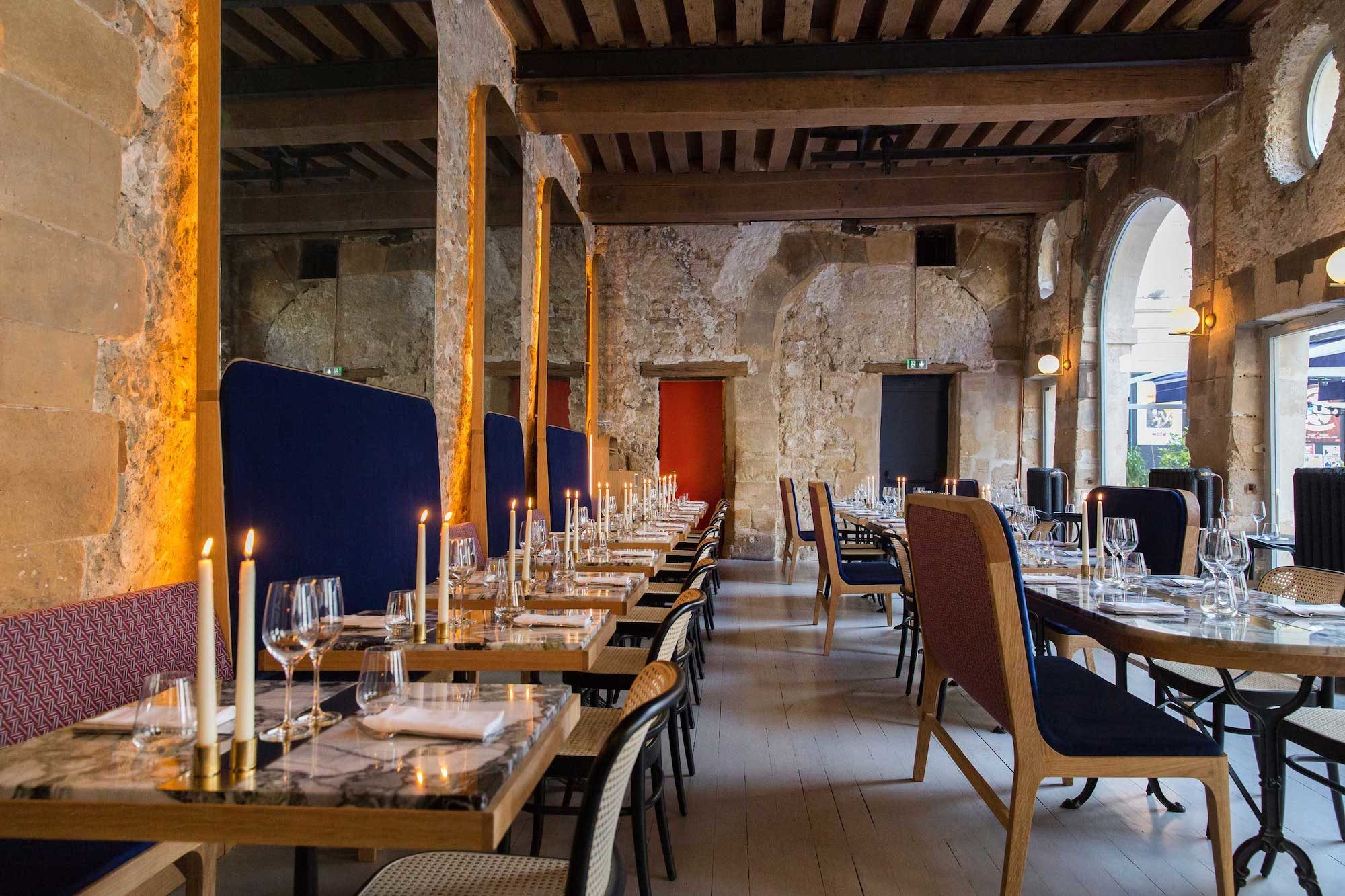 Grandcoeur restaurant in the Marais, Paris, comes with cozy exposed brick interiors and lots of candle light.