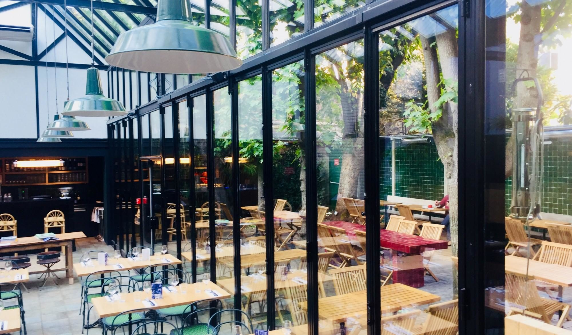 Le Lieu Secret bar in Paris comes with a pretty outdoor terrace with a conservatory for colder days.
