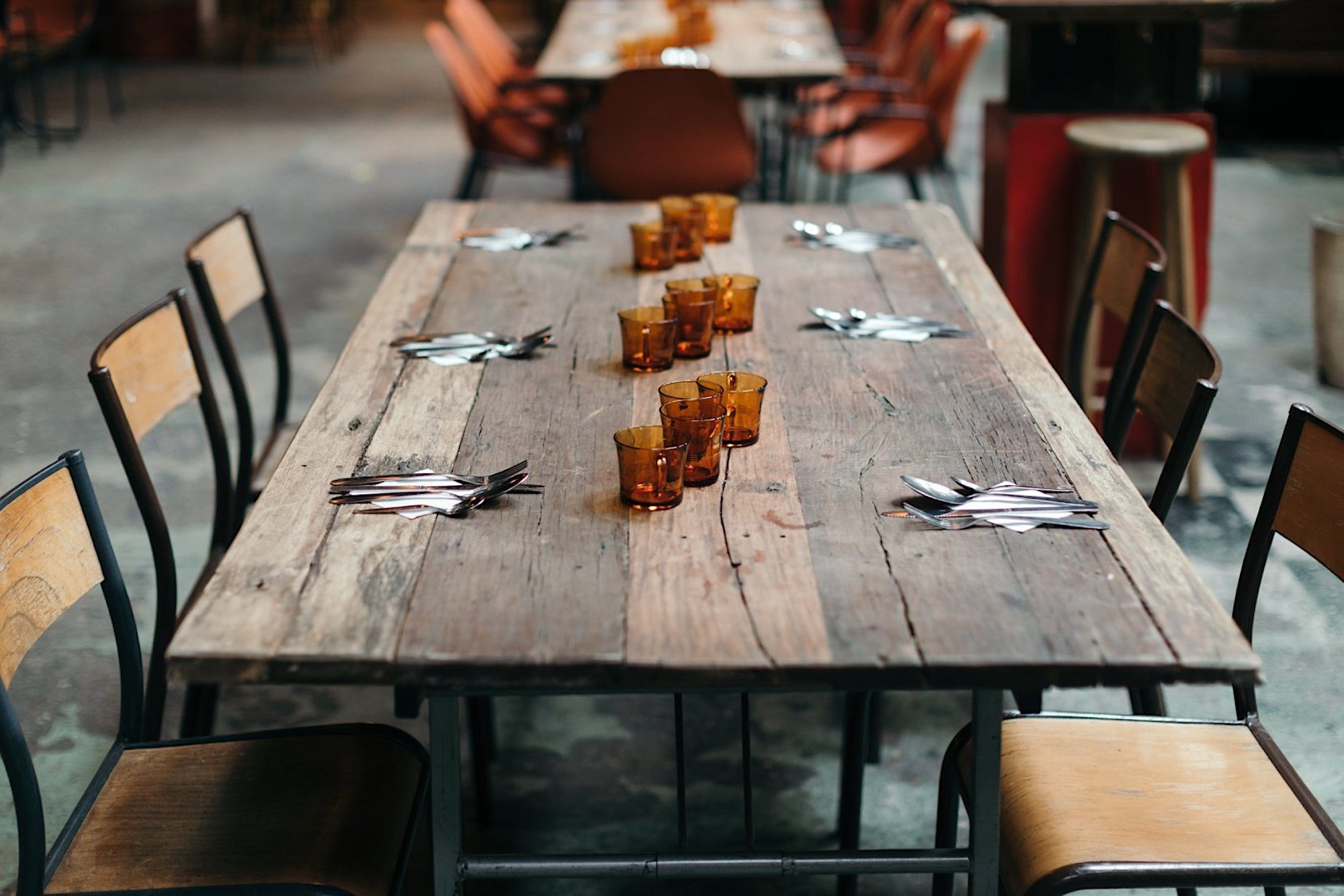A timber table at the bohemian bar and eatery le Comptoir Général on the banks of the Canal Saint Martin.