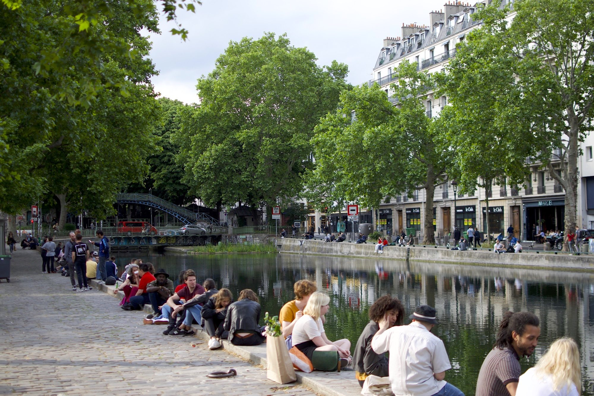 Locals love to come and relax by the water on the banks of the Canal Saint Martin in Paris.