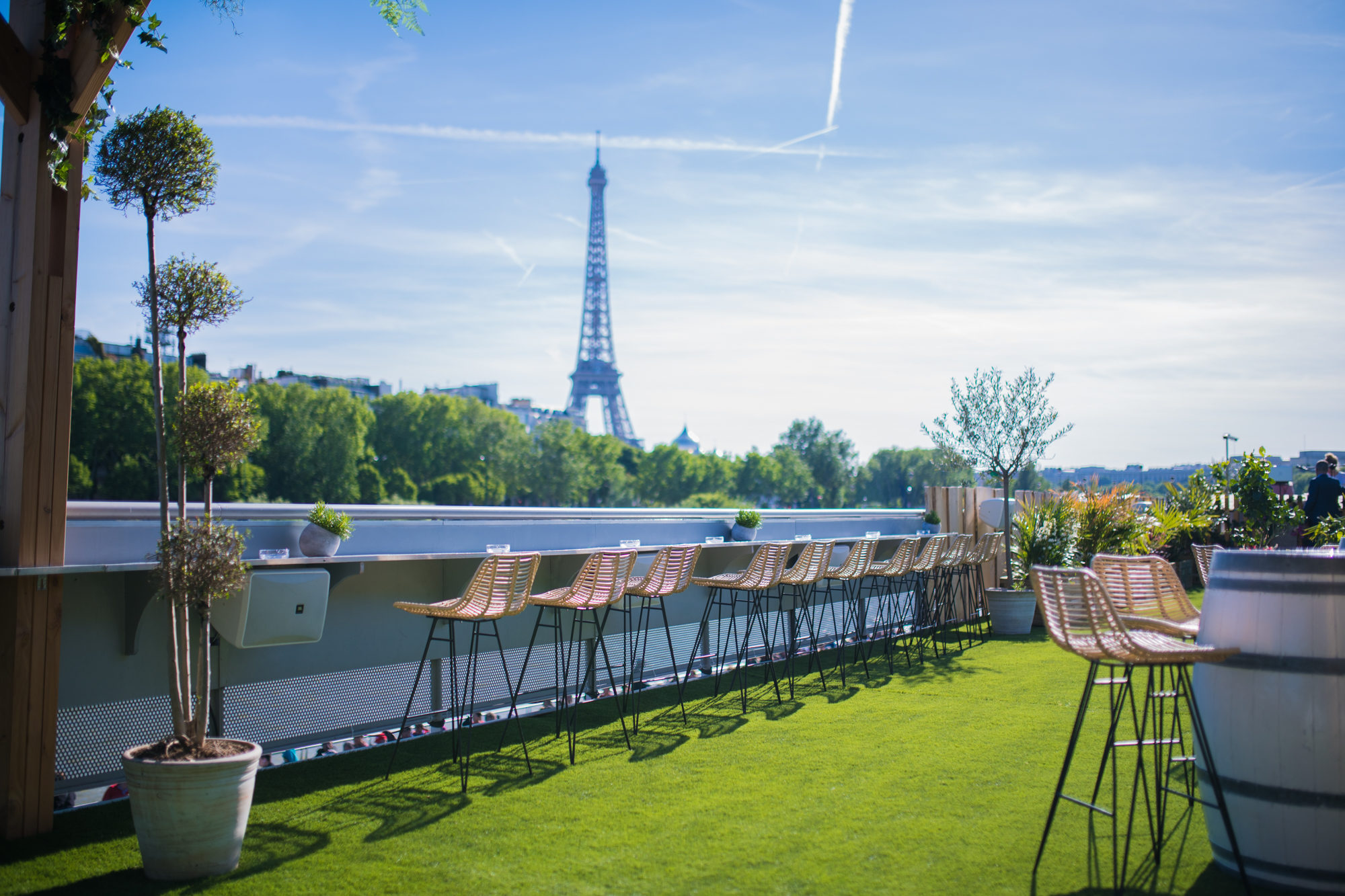 The view of the Eiffel Tower from the top of the barge boat bar Mademoiselle Mouche.