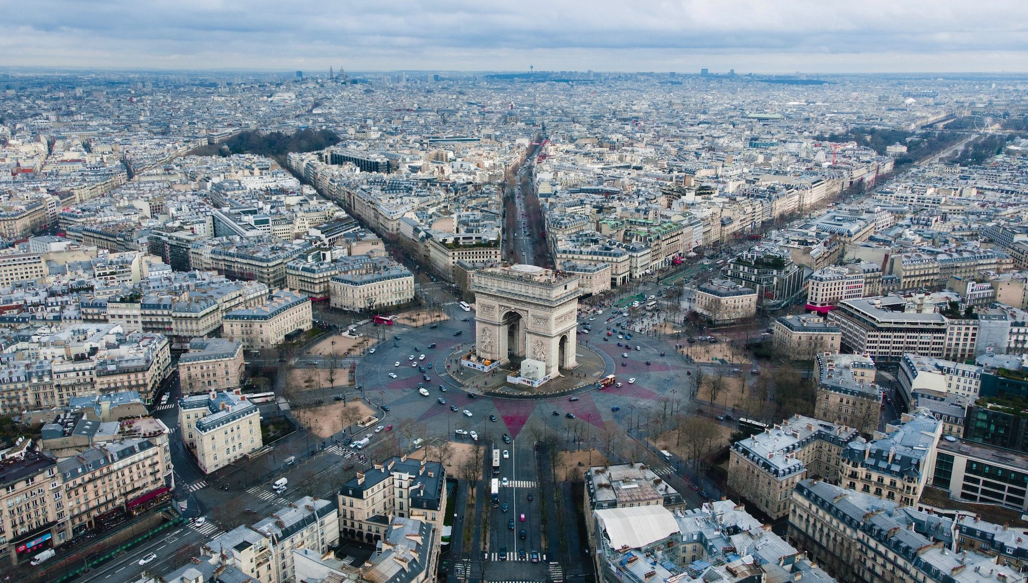 An aerial view of the Arc de Triomphe in Paris, often seen in Netflix movies, which are great for learning French.