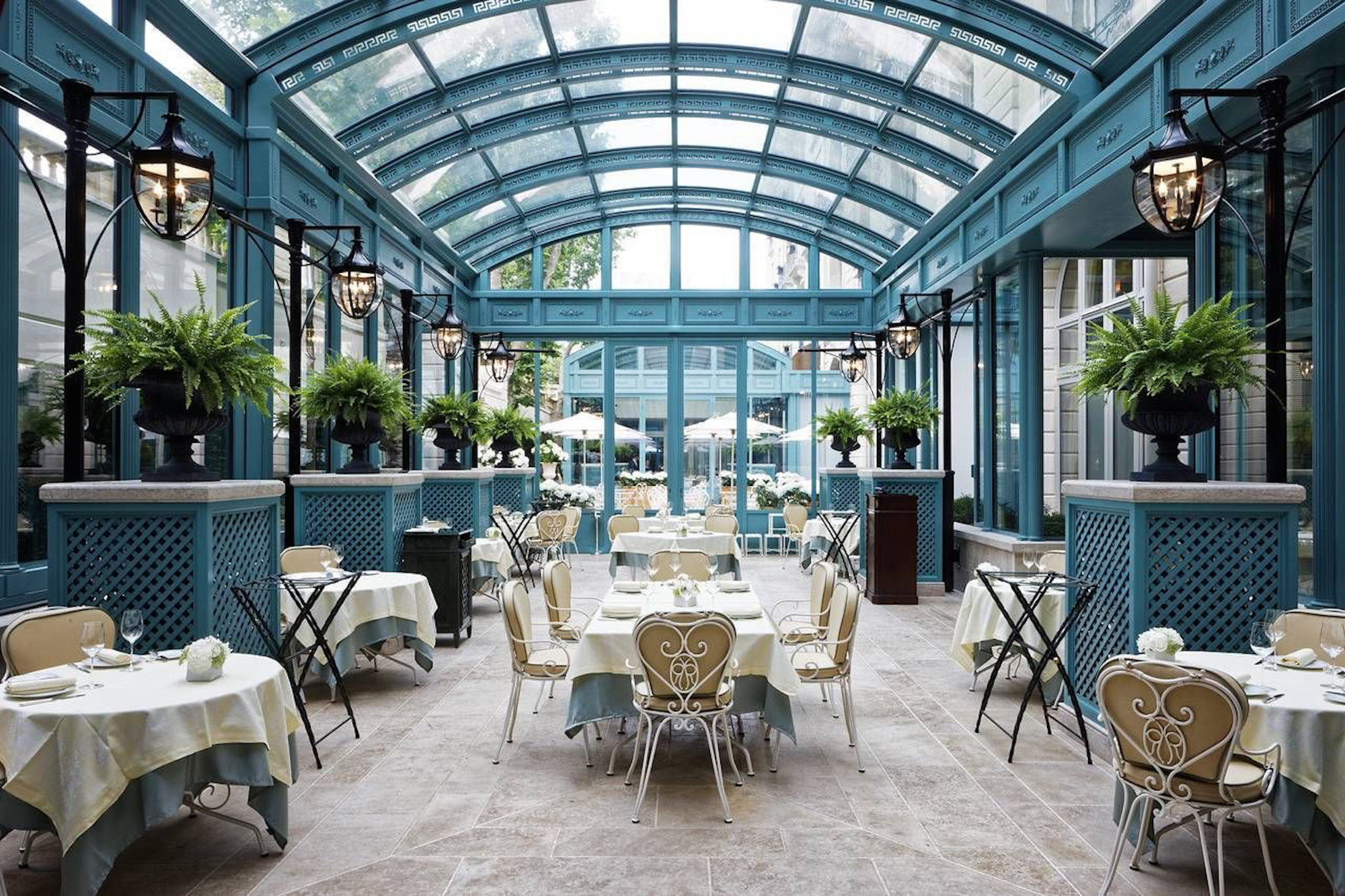 The glass roofed Bar Vendôme at the Ritz Hotel Paris, a perfect spot for dining in the winter sun.