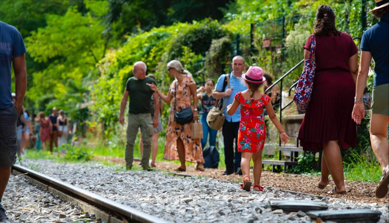 Parisians enjoy a sunny day along the Petite Ceinture, a network of old railway tracks that have transformed into walking paths running through several of Paris' arrondissements.