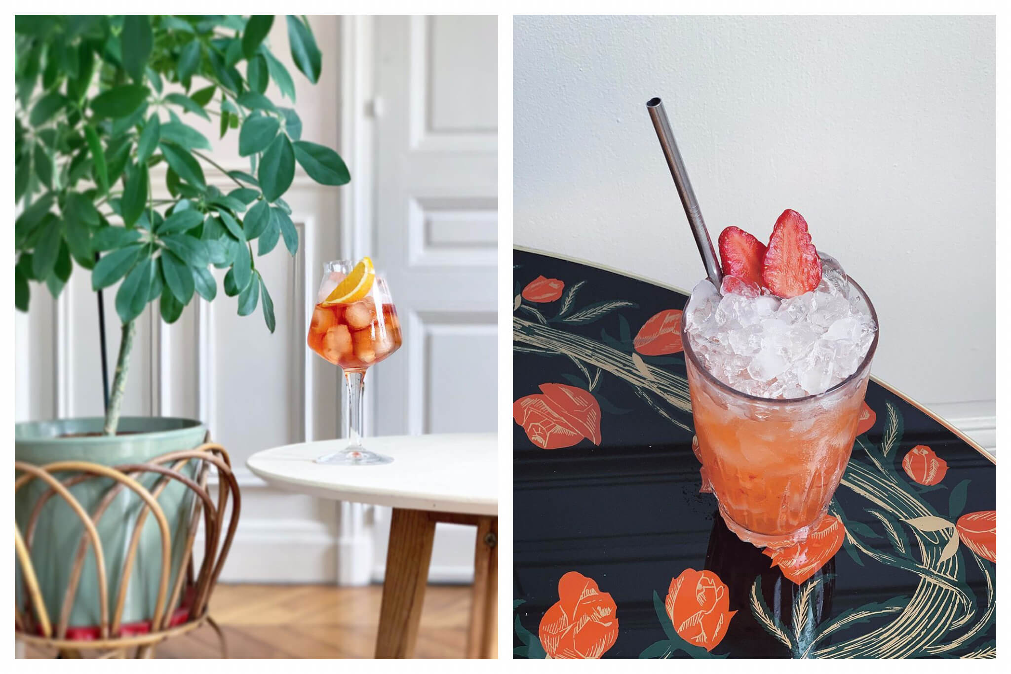 Left: a cocktail with a slice of orange on top sitting on a white table next to a pot plant in a Parisian apartment.  Right: a cocktail with two strawberries on top sitting on a table with a floral design.
