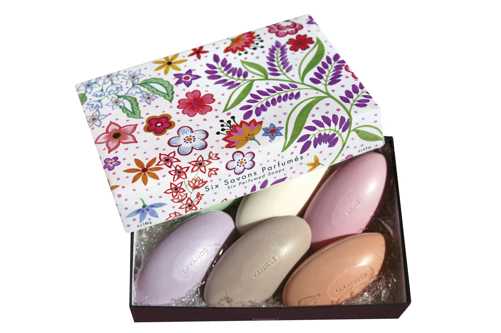A beautiful box with flowers printed on the lid is open to show colorful-- purple, yellow, brown, pink and orange-- Fragonard soaps.