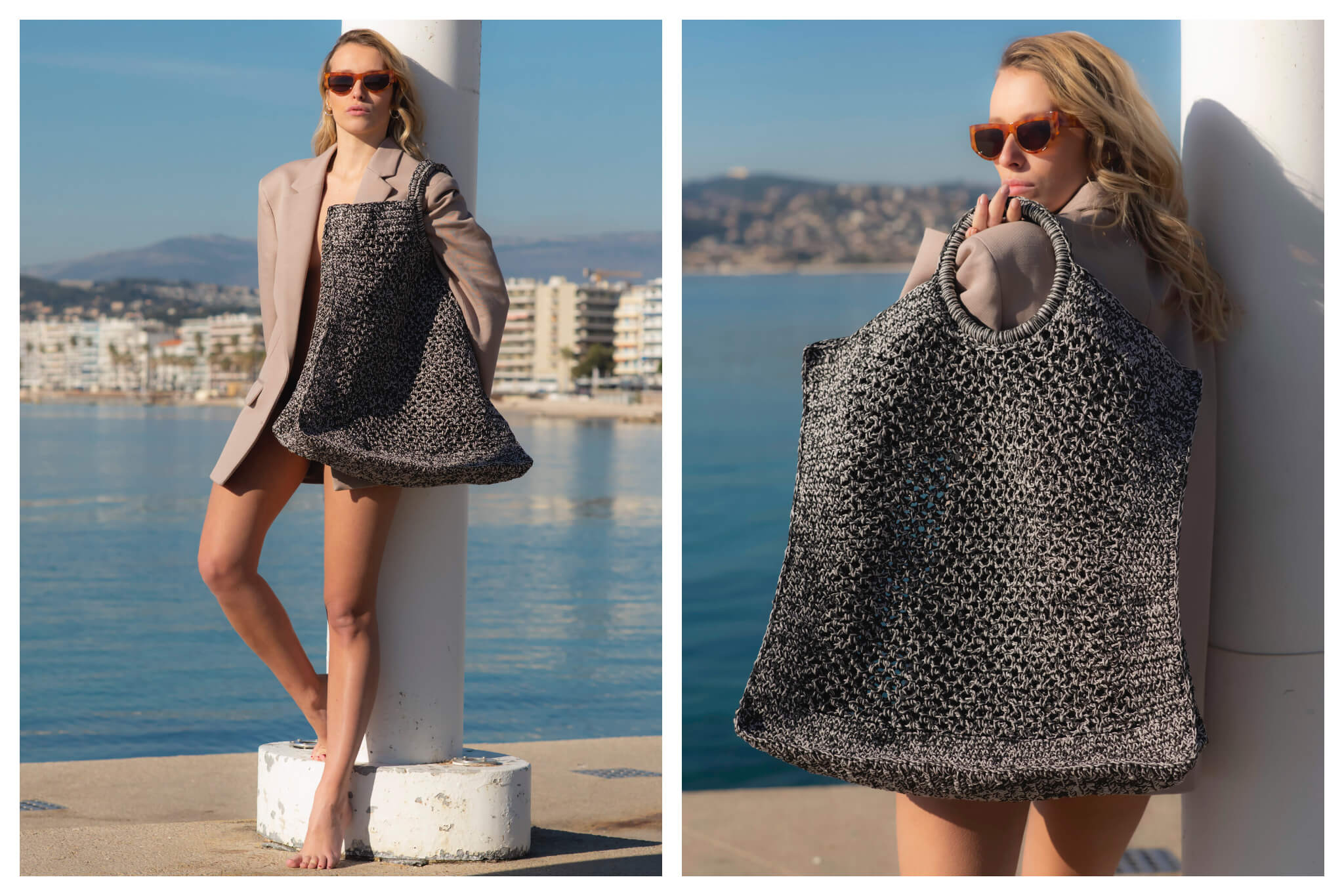 A model in a blazer and red sunglasses models a large bag from Mizele in front of the ocean on a sunny day.