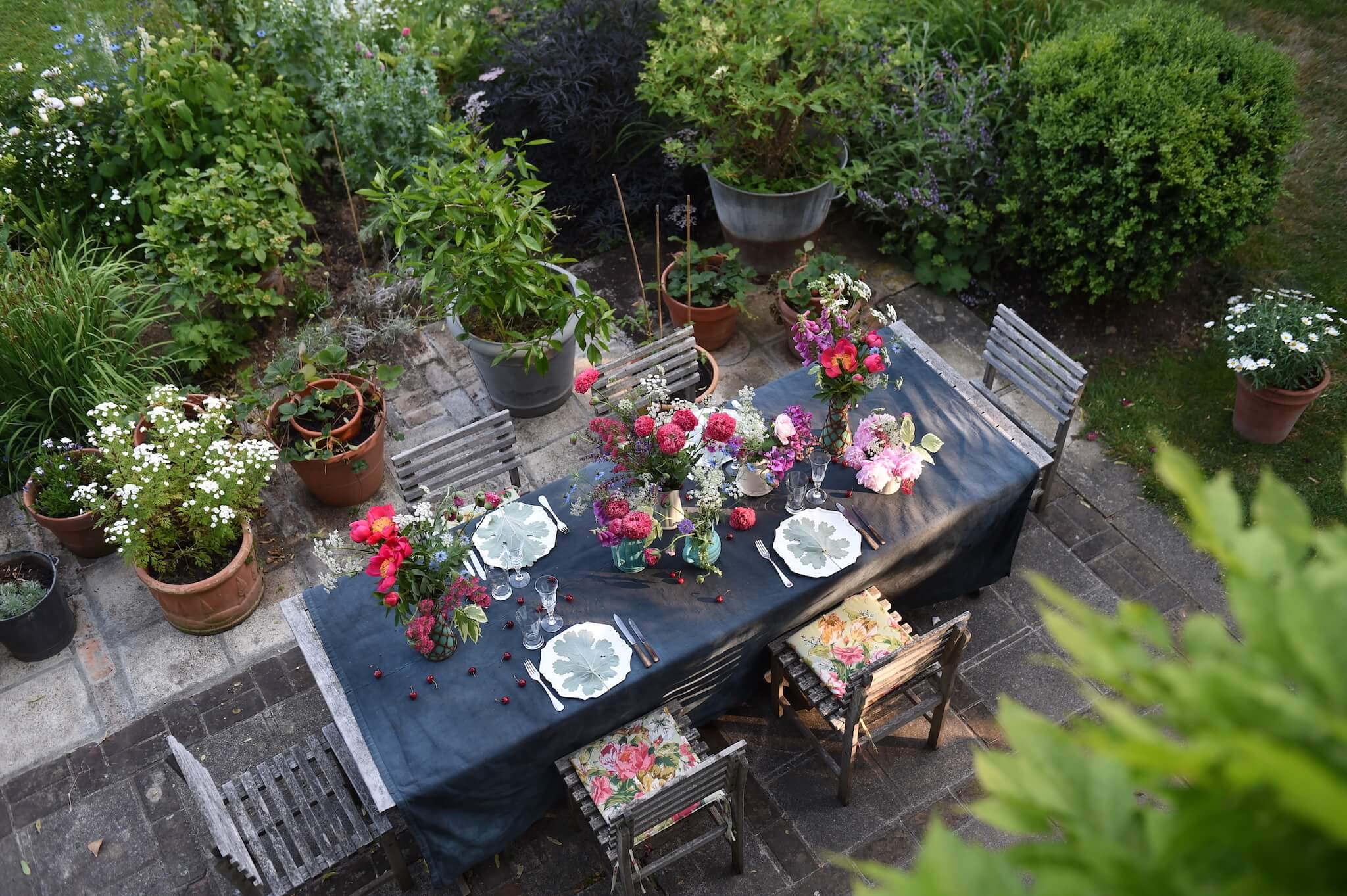 A table set for lunch in a Normandy garden.