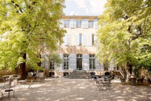 The front of the Hôtel de Gallifet on a sunny day in Aix-en-Provence